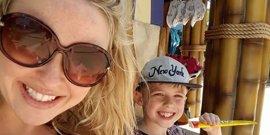 Young mum on holiday with her son